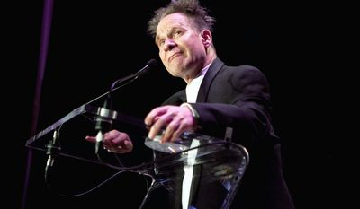 """In this April 29, 2012 photo provided by Opera News, director Peter Sellars is honored at the Opera News Awards in New York, where he won a special award along with four of the world's best singers. Sellars told the guests at he """"took the starch out of the Bugs Bunny version of opera"""" - with productions like the wrenching story of how the nuclear bomb was created in composer John Adams' Grammy award-winning """"Doctor Atomic."""" (AP Photo/Opera News, Dario Acosta)"""