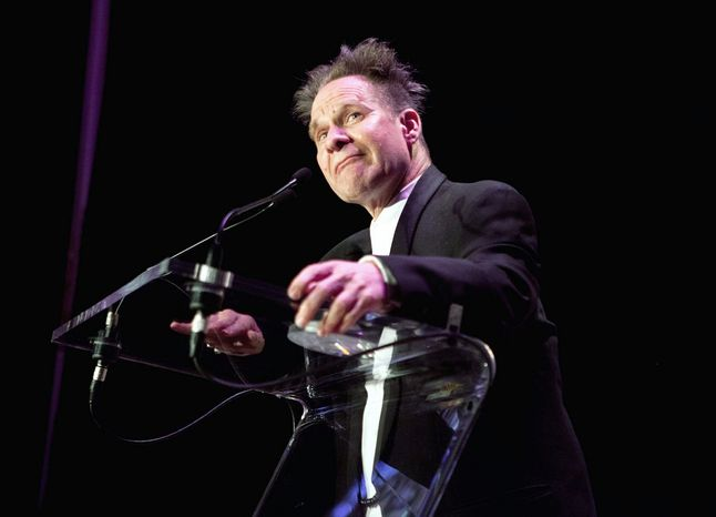 "In this April 29, 2012 photo provided by Opera News, director Peter Sellars is honored at the Opera News Awards in New York, where he won a special award along with four of the world's best singers. Sellars told the guests at he ""took the starch out of the Bugs Bunny version of opera"" - with productions like the wrenching story of how the nuclear bomb was created in composer John Adams' Grammy award-winning ""Doctor Atomic."" (AP Photo/Opera News, Dario Acosta)"