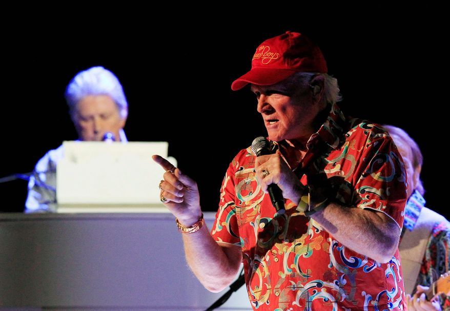 """Mike Love sings and Brian Wilson plays the piano during the opening show of the Beach Boy's 50th anniversary tour in Arizona. """"We're slaves to the Beach Boys legacy,"""" said David Marks, who recorded four albums with the group. """"We're just out there trying to keep that legacy alive."""" (Associated Press)"""