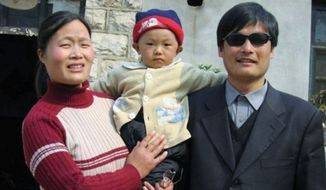 Chinese activist Chen Guangcheng is seen with his wife, Yuan Weijing, and son, Chen Kerui, in an undated photo in China. His escape from house arrest into the reported protection of U.S. diplomats in Beijing poses a delicate U.S.-China issue. (China Aid Association via Associated Press)