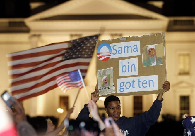 **FILE** Crowds celebrate in front of the White House on May 2, 2011, after President Obama announced that Osama bin Laden had been killed. (Associated Press)