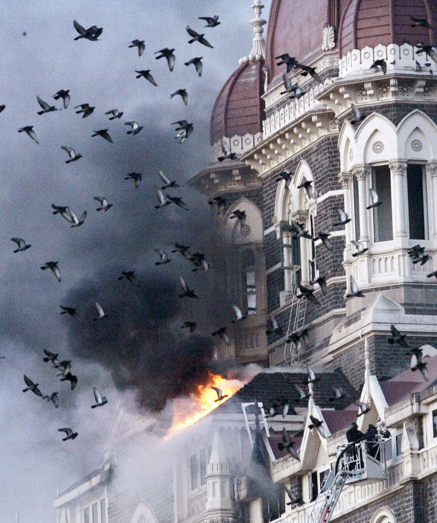 Pigeons fly near burning parts of the Taj Hotel in Mumbai, India, on Nov. 27, 2008. Aggressive counterterrorism efforts - such as drone strikes and economic sanctions - have crippled al Qaeda's ability to replace leaders. (Associated Press)