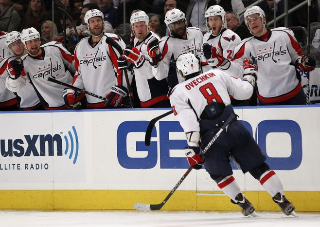Teammates greet Washington Capitals Alex Ovechkin after he scored the winning goal in the third period of Game 2 of the NHL Eastern Conference semifinals at Madison Square Garden in New York, Monday, April 30, 2012. The Capitals defeated the Rangers 3-2. (AP Photo/Kathy Willens)