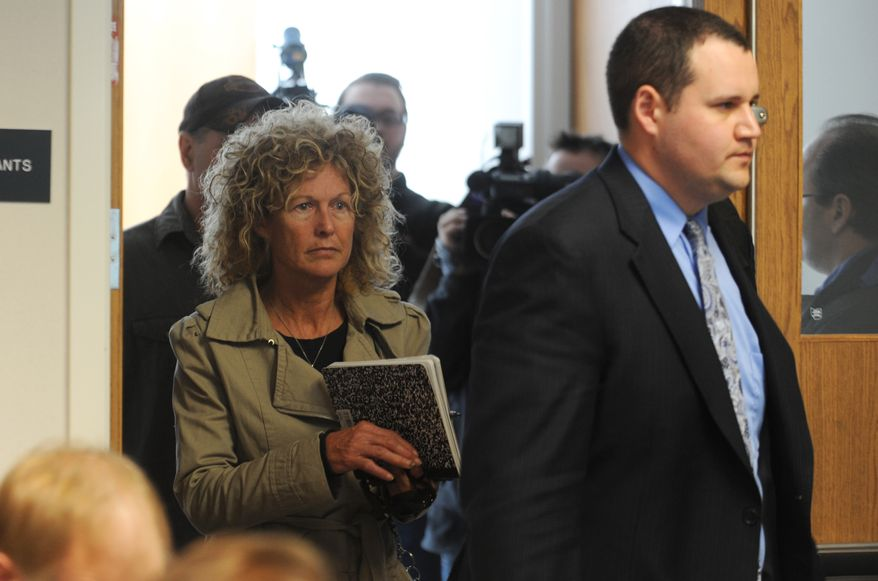Marian Thompson (left) follows her attorney, Bob McClelland, into a hearing at the Ohio Department of Agriculture in Reynoldburg, Ohio, on Monday, April 23, 2012. (AP Photo/Chris Crook, Times Recorder)