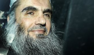 **FILE** Abu Qatada is driven away April 17, 2012, after being refused bail at a hearing at London's Special Immigration Appeals Commission, which handles deportation and security cases, in London. Al Qaeda's North African affiliate offered to free a British hostage if London allowed radical cleric Qatada to leave Britain for another country. (Associated Press)