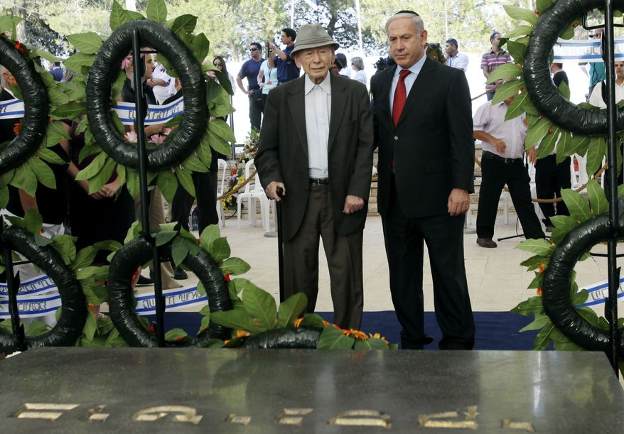 ** FILE ** Israeli Prime Minister Benjamin Netanyahu (right) and his father, Ben-Zion, attend the official memorial service for the late Zionist leader Zeev Jabotinsky on Mount Herzl in Jerusalem in July 2010. (AP Photo/Kobi Gideon, Pool)