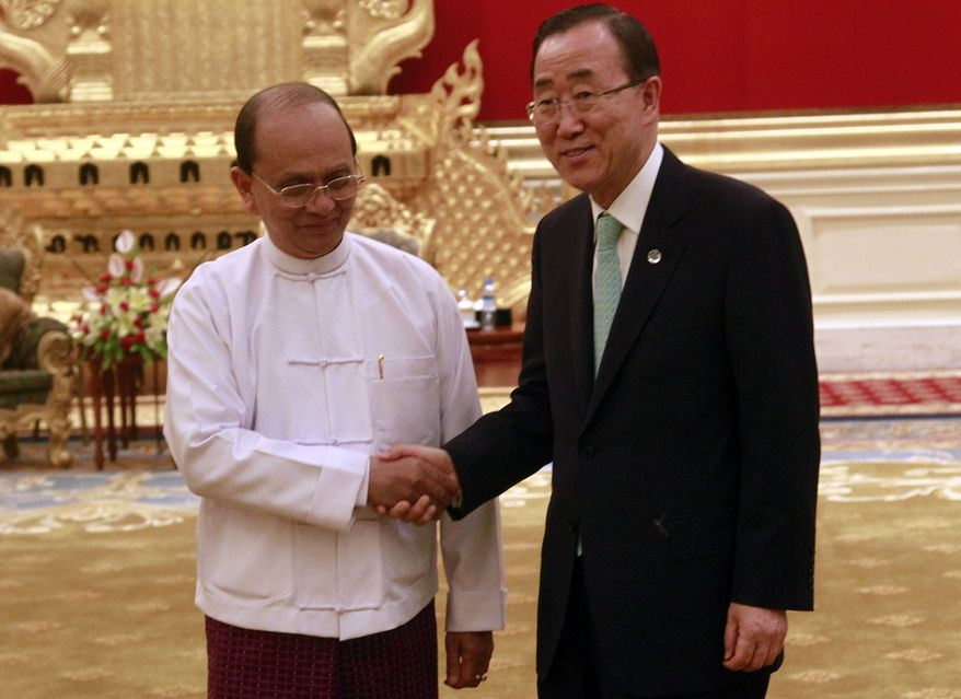 Myanmar President Thein Sein (left) shakes hands with U.N. Secretary-General Ban Ki-moon during their meeting at the presidential house in Naypyitaw, Myanmar, on Monday, April 30, 2012. (AP Photo/Khin Maung Win)