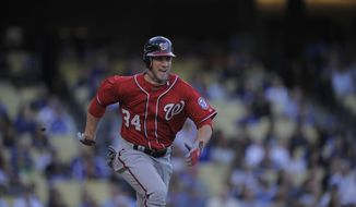 Washington Nationals Bryce Harper runs to first during their baseball game against the Los Angeles Dodgers, Saturday, April 28, 2012, in Los Angeles. Harper was thrown out at first. (AP Photo/Mark J. Terrill)
