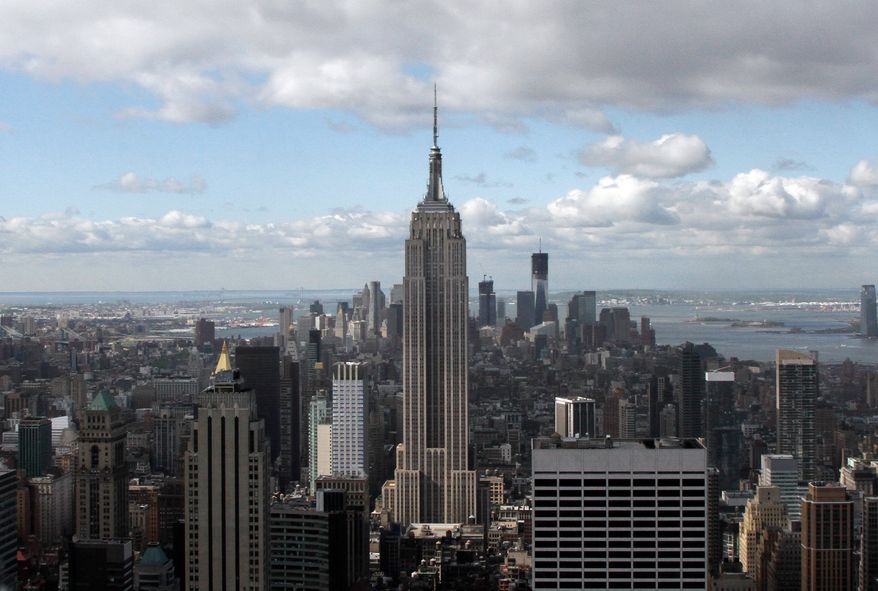 This photo from April 27, 2012, shows the Empire State Building (center) and One World Trade Center (rear right) in New York. (Associated Press)