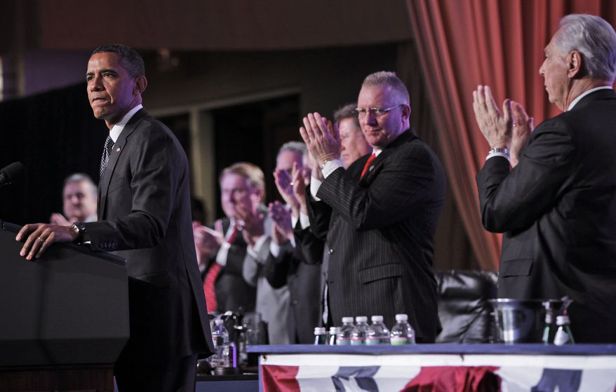 President Obama receives a standing applause from labor leaders as he speaks April 30, 2012, at the Building and Construction Trades Department Legislative Conference in Washington. (Associated Press)