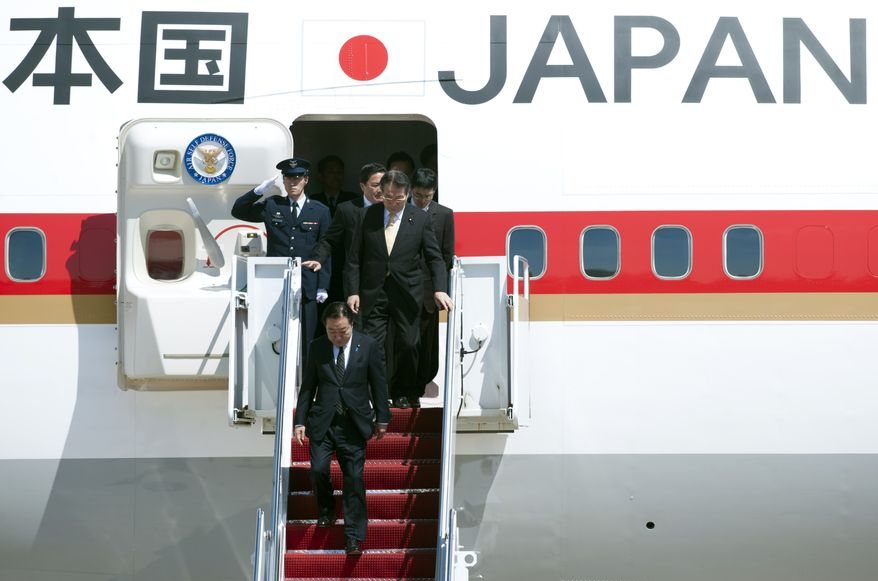 Japanese Prime Minister Yoshihiko Noda (bottom) arrives at Andrews Air Force Base in suburban Washington on Sunday, April 29, 2012. (AP Photo/Cliff Owen)