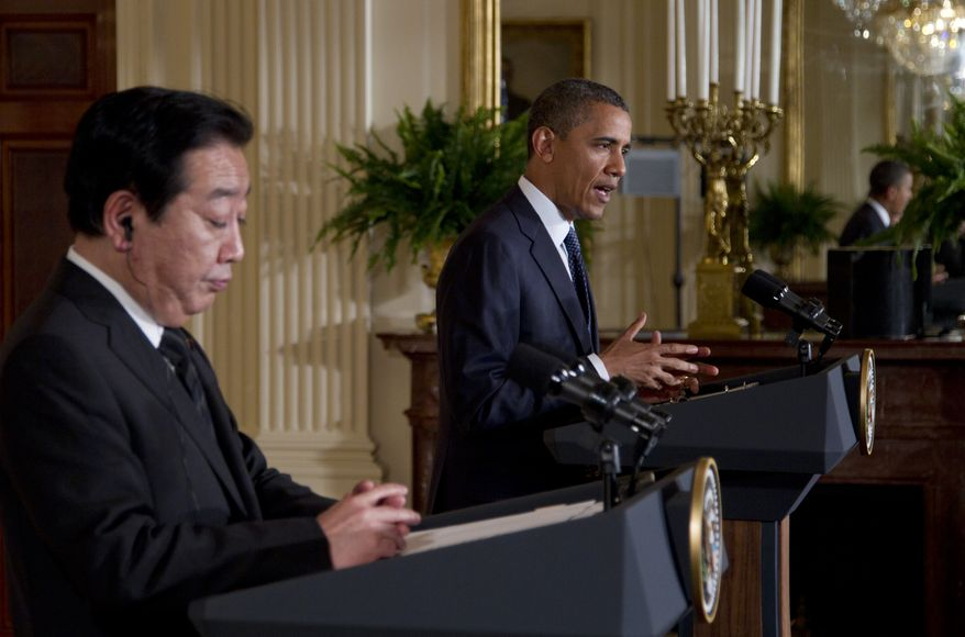 President Obama (right) and Japanese Prime Minister Yoshihiko Noda give a joint news conference on Monday, April 30, 2012, in the East Room of the White House in Washington. (AP Photo/Carolyn Kaster)