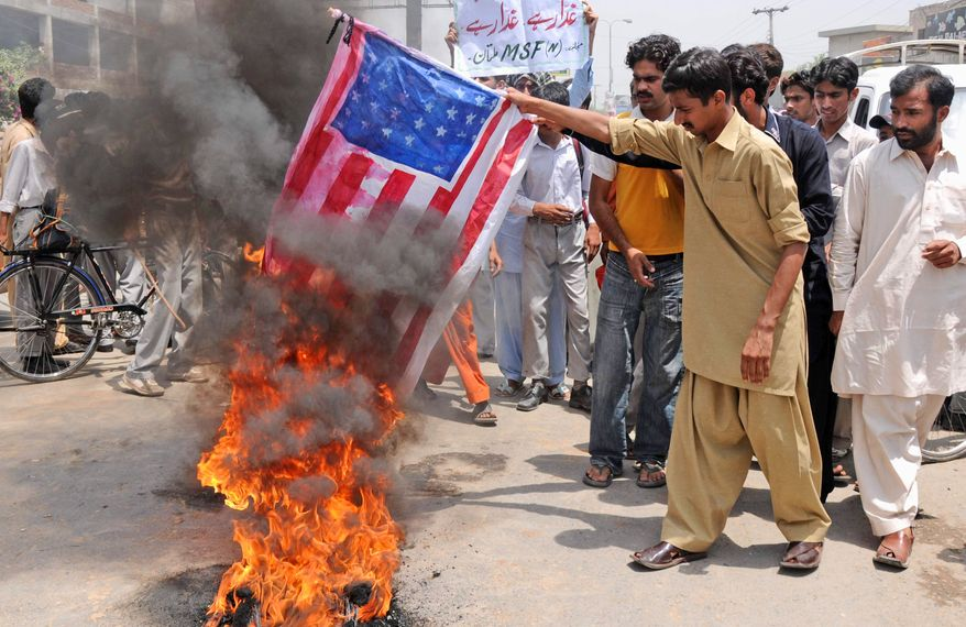**FILE** Supporters of Pakistan's Muslim League burn a representation of the U.S. flag on May 9, 2011, during an anti-American demonstration in Multan, Pakistan. (Associated Press)
