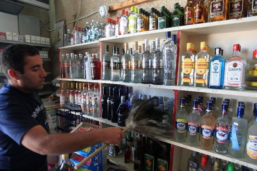 "Patrick Kattoura runs his father's liquor store in Tyre that was heavily damaged by a bomb in December. ""It is my right to sell whatever I want as long as it does not violate Lebanese laws,"" he said. (Associated Press)"