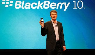 Thorsten Heins, president and CEO of Research in Motion Ltd., shows off a BlackBerry prototype with a new operating system on Tuesday, May 1, 2012, at the BlackBerry World conference in Orlando, Fla. (Associated Press)
