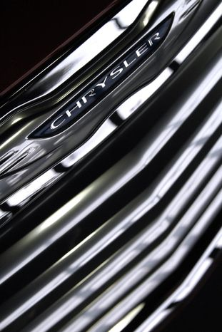 ** FILE ** This Tuesday, Jan. 31, 2012, file photo shows the grill of a 2012 Chrysler 200 in a showroom in South Burlington, Vt. (AP Photo/Toby Talbot)