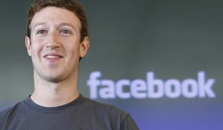 **FILE** Facebook CEO Mark Zuckerberg is seen Oct. 15, 2011, during a meeting in San Francisco. (Associated Press)