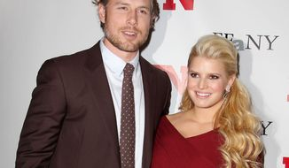 ** FILE ** Singer-actress Jessica Simpson poses with her fiance, Eric Johnson, at the Footwear News Achievement Awards at the Museum of Modern Art in New York on Tuesday, Nov. 29, 2011. (AP Photo/Starpix, Amanda Schwab)