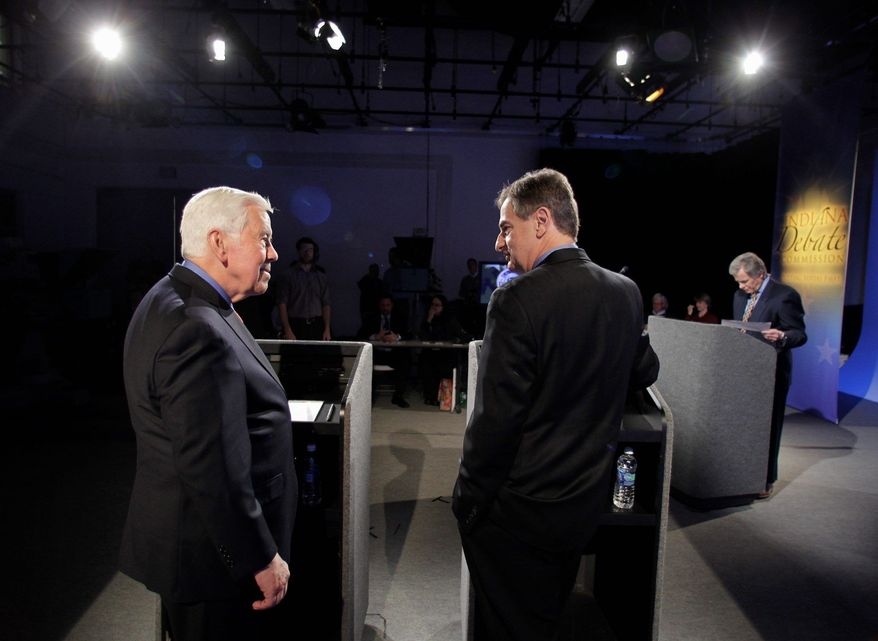 Six-term Sen. Richard G. Lugar (left), Indiana Republican, debated state Treasurer Richard Mourdock in April during the political fight of his life. The Indiana primary is set for Tuesday. (Associated Press)