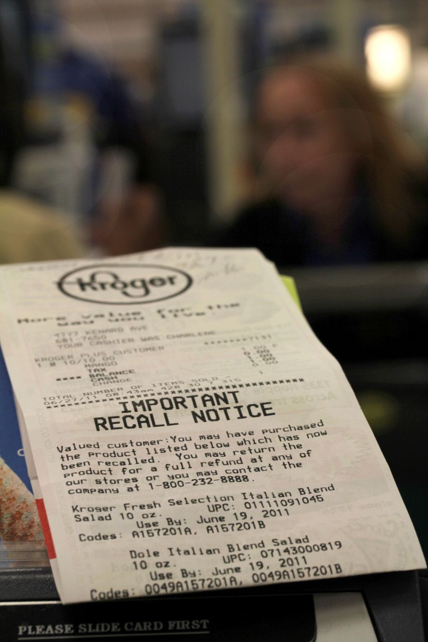 **FILE** A store receipt with a food recall notice on it sits June 27, 2011, near a check-out lane at a Cincinnati Kroger grocery store. Tyson Fresh Meats Inc. recalled Sept. 28, 2011, about 131,300 pounds of ground beef was possibly contaminated with E. coli, the U.S. Department of Agriculture said. (Associated Press)