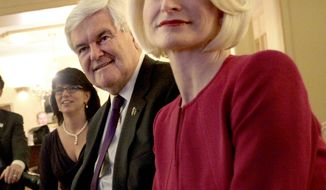 **FILE** Republican presidential candidate and former House Speaker Newt Gingrich sits with his wife, Callista (right), and his daughter, Jackie Gingrich Cushman, in Birmingham, Ala. (Associated Press)