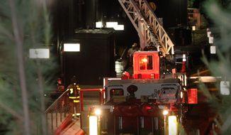 Atlanta firefighters extinguish a 4-alarm blaze at Tyler Perry Studios in southwest Atlanta on May 1, 2012. (Associated Press/Atlanta Journal-Constitution)