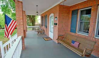 The home has a wide front porch complete with a swing that will convey to the new owners.