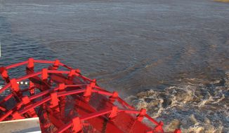 In this April 27, 2012 photo, the red paddle wheel of the American Queen steamboat churns as it propels the vessel on a Memphis to Cincinnati cruise on the Mississippi and Ohio rivers in Memphis, Tenn. (AP Photo/Adrian Sainz)