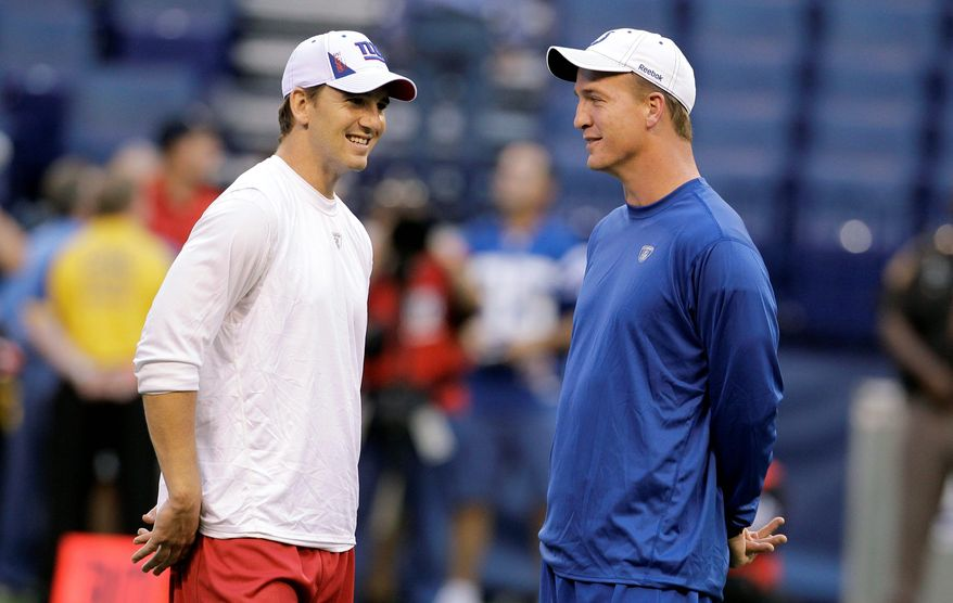 "New York Giants quarterback Eli Manning (left), with brother Peyton Manning, will host ""Saturday Night Live"" this week after turning down a chance to do so four years ago. (Associated Press)"