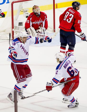 New York Rangers forwards Marian Gaborik and Carl Hagelin celebrate Gaborik's goal in the third overtime period Wednesday night. The Capitals need a bounce-back performance from rookie goalie Braden Holtby, who has gone 25 NHL games without back-to-back losses. (Andrew Harnik/The Washington Times)