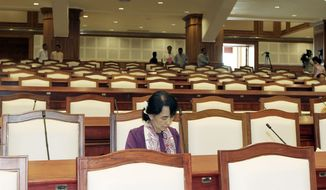 Myanmar pro-democracy icon Aung San Suu Kyi spent her first day as a member of her country's parliment on Wednesday. She will have almost no power since her political party holds only a few dozen seats, but she will have an official voice in government for the first time. (Associated Press)