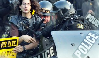 Riot police seize a protester at the G-8 and G-20 summits in Toronto in 2010. Protests at this month's NATO Summit in Chicago will miss an opportunity to double up on the G-8 because President Obama moved it to Camp David. (Associated Press)
