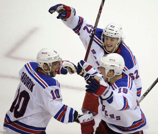 New York Rangers right wing Marian Gaborik (10) celebrates his winning goal against the Washington Capitals with teammates Carl Hagelin (62) and Marc Staal (18) during the third overtime period of Game 3 of an NHL hockey Stanley Cup second-round playoff series, in Washington, early Thursday, May 3, 2012. The Rangers beat the Capitals 2-1. (AP Photo/Susan Walsh)