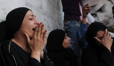 Egyptian women mourn the deaths of victims of clashes outside the Defense Ministry in Cairo on Wednesday, May 2, 2012. (AP Photo/Mohammed Asad)