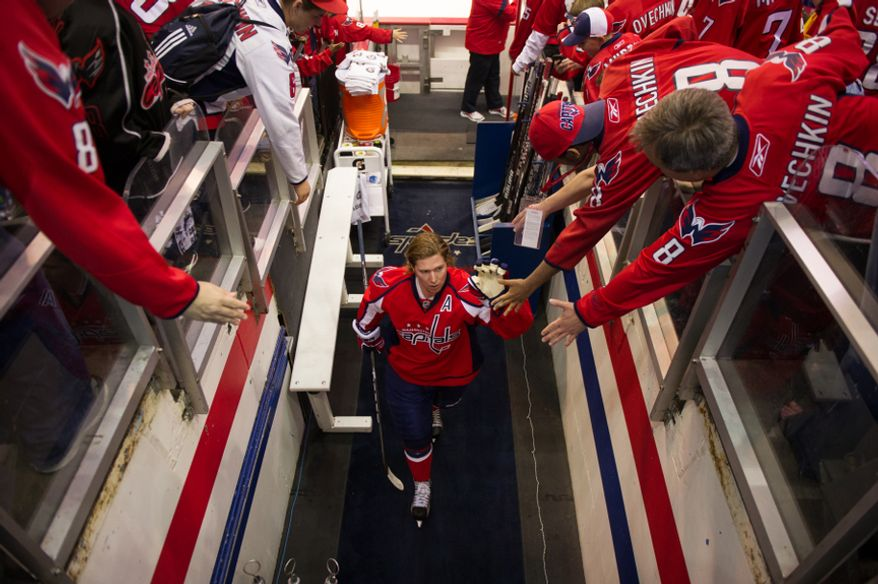 Washington Capitals center Nicklas Backstrom (19) high fives with fans before the Washington Capitals take on the New York Rangers in playoff NHL hockey at the Verizon Center, Washington, D.C., Wednesday, May 2, 2012. (Andrew Harnik/The Washington Times)