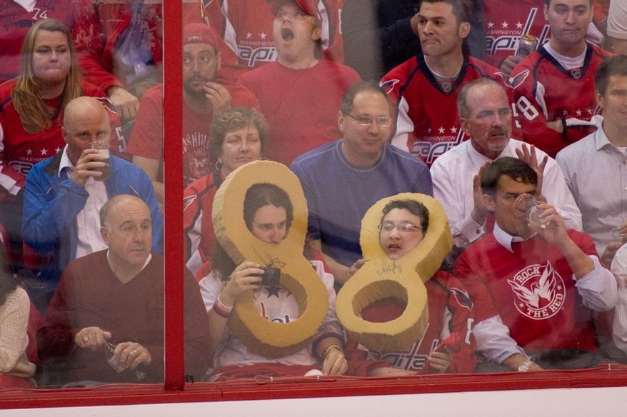 Fans of Washington Capitals left wing Alex Ovechkin (8) wear cutouts of his number in the second period as the Washington Capitals take on the New York Rangers in playoff NHL hockey at the Verizon Center, Washington, D.C., Wednesday, May 2, 2012. (Andrew Harnik/The Washington Times)