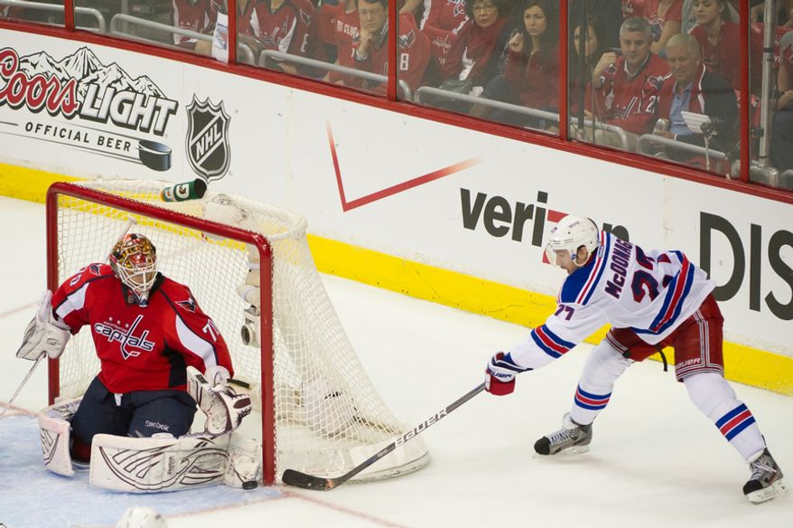 Washington Capitals goalie Braden Holtby (70) blocks a shot on goal by New York Rangers defenseman Ryan McDonagh (27) in the third period as the Washington Capitals lose to the New York Rangers, 2-1, in triple overtime in playoff NHL hockey at the Verizon Center, Washington, D.C., Wednesday, May 2, 2012. (Andrew Harnik/The Washington Times)