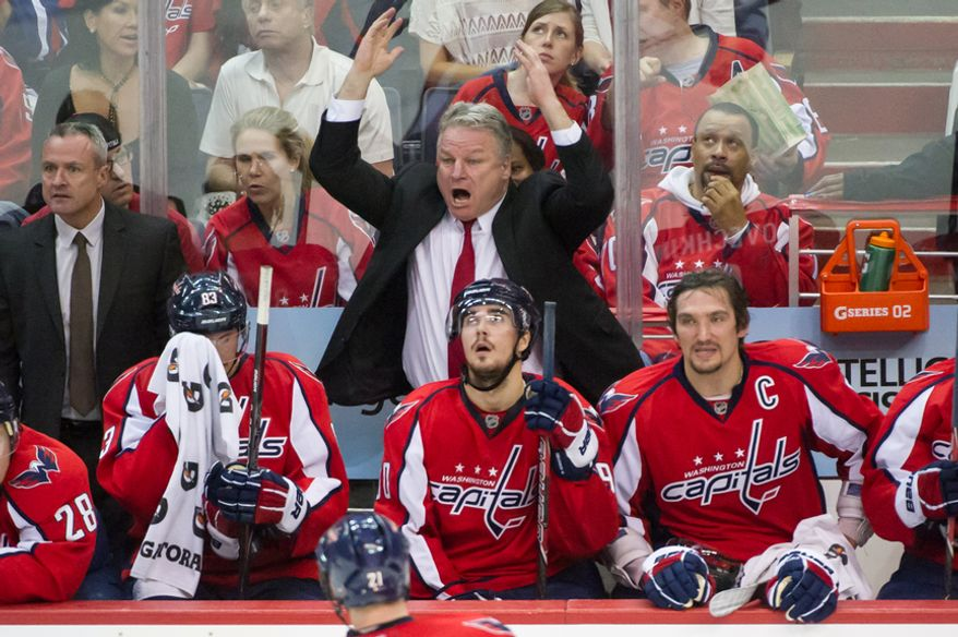 Washington Capitals head coach Dale Hunter reacts to the replay of a questionable foul in the third period as the Washington Capitals lose to the New York Rangers, 2-1, in triple overtime in playoff NHL hockey at the Verizon Center, Washington, D.C., Wednesday, May 2, 2012. (Andrew Harnik/The Washington Times)