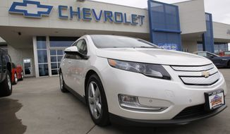A 2012 Chevrolet Volt is on display outside a Chevy dealership in the south Denver suburb of Englewood, Colo., on Sunday, Feb. 19, 2012. (AP Photo/David Zalubowski)