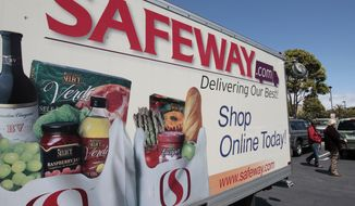 A Safeway online shopping advertisement is shown at a Safeway store in San Francisco on April 26, 2012. (Associated Press)