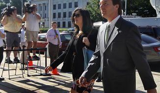 Former Sen. John Edwards and his daughter Cate Edwards enter the federal courthouse in Greensboro, N.C., on Thursday, May 3, 2012, for his trial on campaign finance violations. (AP Photo/The News & Observer, Chuck Liddy)