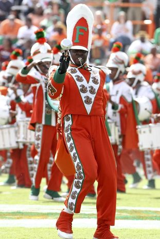 **FILE** Florida A&M Marching 100 drum major Robert Champion performs Oct. 8, 2011, at halftime of the game against Howard University at Bragg Memorial Stadium in Tallahassee, Fla. (Associated Press)