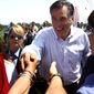 ** FILE ** Republican presidential candidate, former Massachusetts Gov. Mitt Romney, greets supporters during a campaign stop in Portsmouth, Va., on Thursday, May 3, 2012. (AP Photo/Virginian-Pilot, Ross Taylor)
