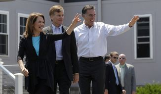 Republican presidential candidate, former Massachusetts Gov. Mitt Romney, from right, Rep. Michele Bachmann, R-Minn., and Virginia Gov. Bob McDonnell arrive at a campaign stop in Portsmouth, Va., Thursday, May 3, 2012. (AP Photo/Jae C. Hong)