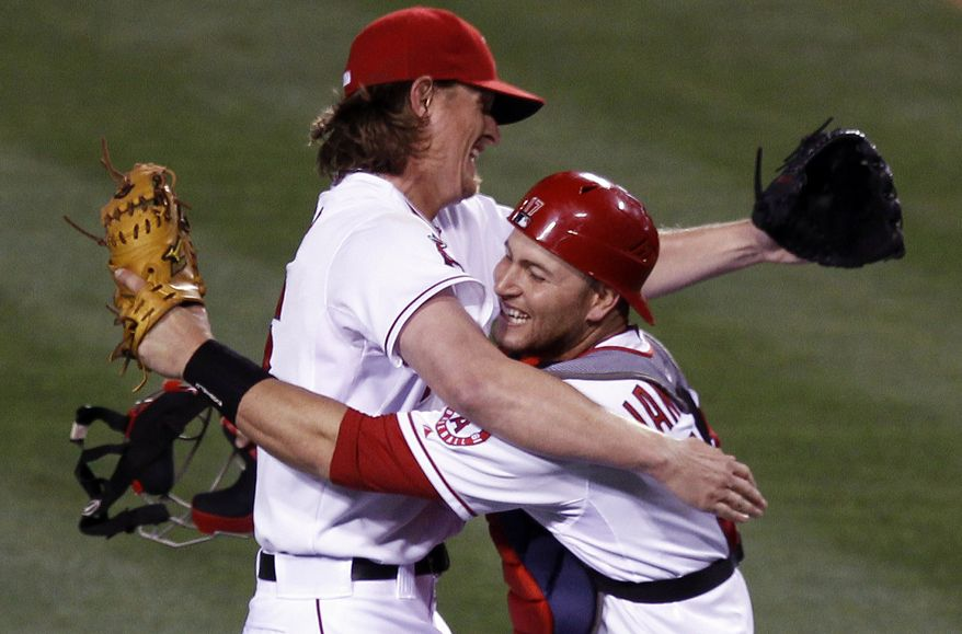 Los Angeles Angels starting pitcher Jered Weaver celebrates his no-hitter against the Minnesota Twins with catcher Chris Iannetta at a baseball game in Anaheim, Calif., on Wednesday, May 2, 2012. (AP Photo/Chris Carlson)