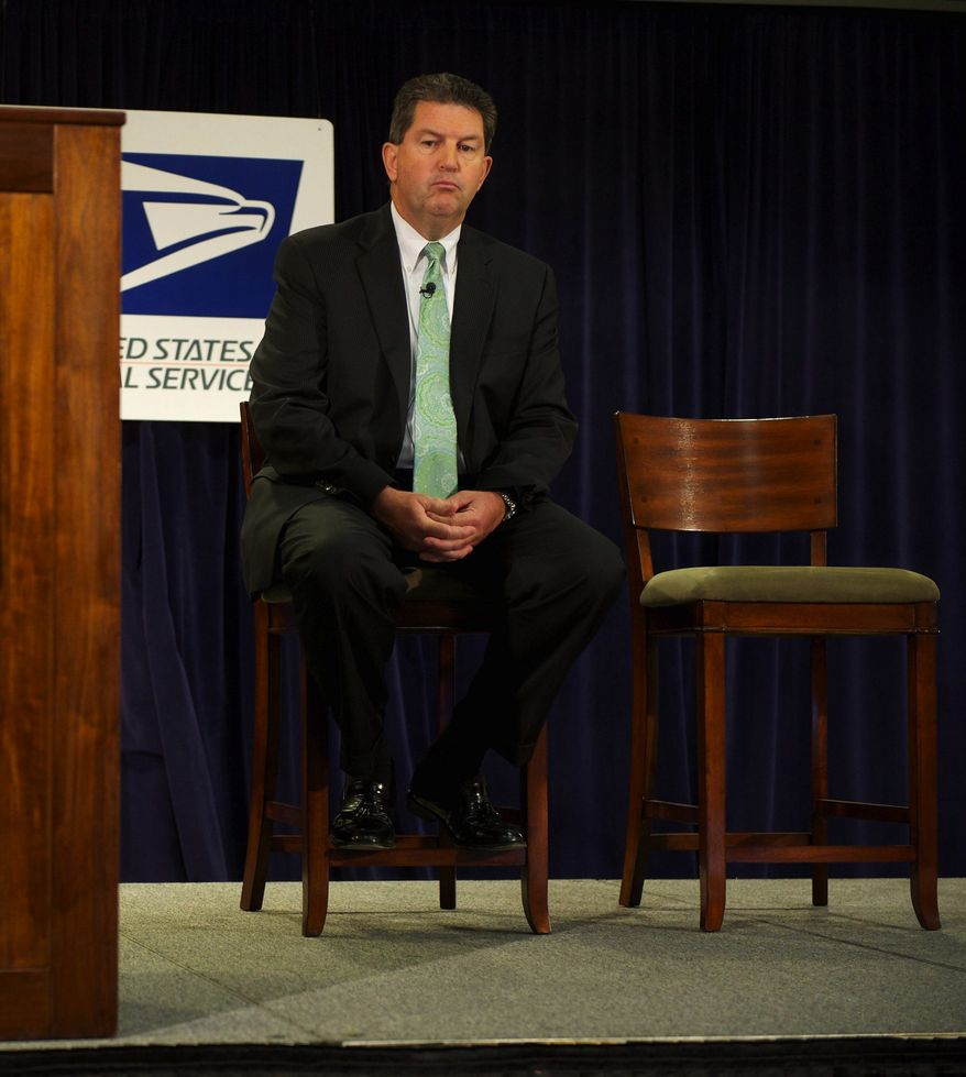 **FILE** Postmaster General Patrick R. Donahoe sits onstage during a Sept. 15, 2011, press conference. (Rod Lamkey Jr./The Washington Times)