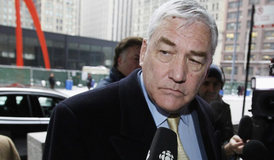 In this Jan. 13, 2011, file photo, former media mogul Conrad Black arrives at the federal building in Chicago. Black was released from a federal prison in Miami early Friday, May 4, 2012, after serving about three years for defrauding investors. (AP Photo/Charles Rex Arobasgt, File)