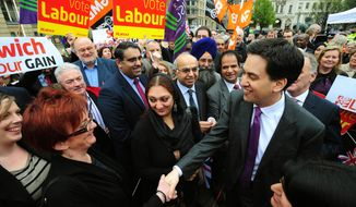 Labour Party leader Ed Miliband shakes hands with wellwishers in Birmingham, England, Friday May 4, 2012. Prime Minister David Cameron's Conservative Party took an electoral bruising Friday, suffering widespread losses in local elections as voters punished the leader for biting austerity measures and a stalled economy. Main opposition Labour Party leader Ed Miliband toasted his own party's revival after its ousting from national office in the 2010 national election. By Friday morning it had won control of 22 local authorities and claimed at least 470 new council seats. (AP Photo/PA, Rui Vieira)