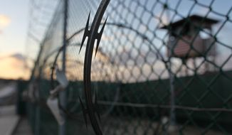 **FILE** The sun rises May 13, 2009, over the Guantanamo detention facility at the Guantanamo Bay U.S. Naval Base, Cuba. (Associated Press)