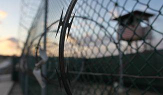 **FILE** The sun rises May 13, 2009, over the Guantanamo detention facility at the Guantanamo Bay U.S. Naval Base, Cuba. (Associated Press)